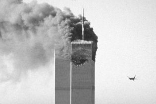 NEW YORK CITY, NY - SEPTEMBER 11: A hijacked commercial plane approaches the World Trade Center shortly before crashing into the landmark skyscraper 11 September 2001 in New York. (Photo credit should read SETH MCCALLISTER/AFP/Getty Images)